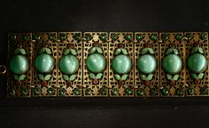Early 1900s Eastern European Enamel and Glass Bracelet, Brass (sold)  This bracelet is two whole inches wide, and dripping in early 20th century Eastern European goodness.