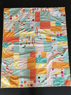 Infant Quilt, Modern- This is a quilt that I made for an expecting mother in a homeless shelter as part of a drive that my quilting guild is doing this fall, LAMQG. Piecing and Quilting by Greg Stewart, 09.2016