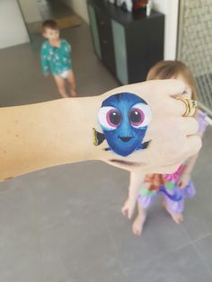Finding Dory - Baby Dory Face Painting By Surreal Strokes Face Painting. https://m.facebook.com/SurrealStrokesFacePainting/