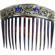 This beautiful hair comb was made in Germany and in style probably dates from the mid 19th century.  CONDITION: the front of the comb is in ...