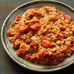 Muhammara I Ottolenghi recipes I This classic Levantine dip can be made in a food processor, but it will lose some of its lovely texture; I'd use a pestle and mortar, if you can. Muhammara keeps well and even improves after a day in the fridge Yotam Ottolenghi, Ottolenghi Recipes, Veggie Recipes, Vegetarian Recipes, Cooking Recipes, Healthy Recipes, Muhammara Recipe, Dips, Turkish Recipes