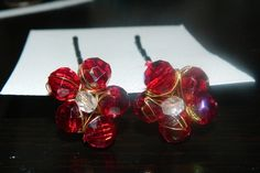 These beautiful cranberry crystals wire wrapped to form flowers and attached to bobby pins for a great accent to beautiful hair style.