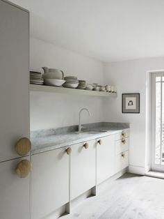Faye Toogood's kitchen in London - I adore those handles. Kooky and unexpected.