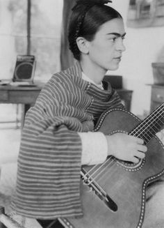 Young Frida Kahlo playing the guitar | music | artist | troubled | iconic | feminist | colour | emotion | striped poncho | mexican | natural beauty | dark hair and eyebrows | icon