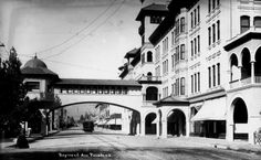 - Exterior view of the Green Hotel in Pasadena. The bridge that extends from the building crosses over Raymond Avenue. Pasadena trolley can be seen travelling on Raymond Avenue. Water and Power Associates San Gabriel Mountains, San Gabriel Valley, California History, Southern California, Vintage California, Altadena California, Hotels In Pasadena, San Luis Obispo County, Los Angeles Area