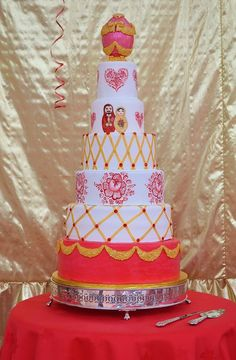 A lovely Russian themed wedding cake by The Hand Painted Cake made with our Floral Swag mold