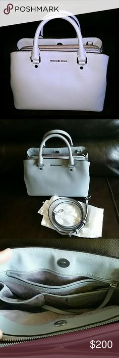 Mikhail kors Medium Satchel Medium Savannah dusty blue color satchel with adjustable shoulder strap, 1 back zip pocket, 2 back slip pockets,  1 large center pocket, 2 front slip pockets,  1 key clip , been used only 2 times. In Very great condition,  no stains. Comes with white  dust bag. Michael Kors Bags Satchels