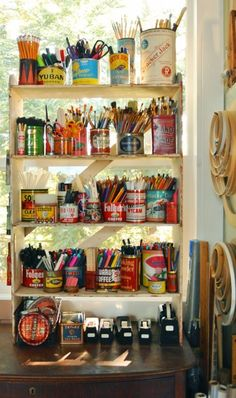 Now that is fabulous inexpensive storage! I love all of the embroidery hoops on the wall, that's how I keep my embroidery hoops, frames, and tapestry looms! Textile tools are always attractive!