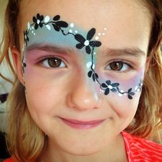 Face painting - simple black and white flower branch with coloured base.