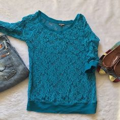 Express lace top Turquoise 3/4 express top Lace through out  Band at bottom Size small Only worn once  Please ask for additional pictures, measurements, or ask questions before purchase No trades or other apps. Ships next business day, unless otherwise noted in my closet Five star rating Bundle for discount Express Tops