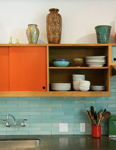 Contrasting colors for a bright, sunny kitchen? Yes please. The beautiful backsplash doesn't hurt either...
