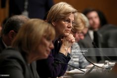 Senate Health, Education, Labor and Pensions Committee member Sen. Elizabeth Warren (D-MA) listens to testimony from Betsy DeVos, President-elect Donald Trump's pick to be the next Secretary of Education, during her confirmation hearing in the Dirksen Senate Office Building on Capitol Hill  January 17, 2017 in Washington, DC. DeVos is known for her advocacy of school choice and education voucher programs and is a long-time leader of the Republican Party in Michigan.  (Photo by Chip…
