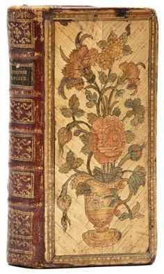 Straw bindings are rare and one in this remarkable state of preservation is of the utmost rarity  1778 Straw Binding - Nouvelles Étrennes Spirituelles, woodcut frontispiece and vignettes, occasional light staining, handsome contemporary straw binding over red morocco, covers with straw mosaics in natural tones, greens, browns and oranges depicting flowers in a vase (upper cover) and a bouquet of flowers tied with a ribbon, a little chipping to straw borders.