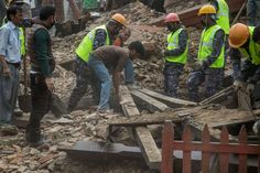 Emergency workers and bystanders clear debris while searching for survivors under a collapsed temple in Basantapur Durbar Square following an earthquake on April 25, 2015 in Kathmandu, Nepal. A major 7.8 earthquake hit Kathmandu mid-day on Saturday, and was followed by multiple aftershocks that triggered avalanches on Mt. Everest that buried mountain climbers in their base camps. Many houses, buildings and temples in the capital were destroyed during the earthquake, leaving hundreds dead or…