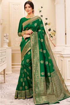 Forest Green banarasi silk saree with forest green silk blouse. Embellished with woven zari work. Saree with Round Neck, Elbow Sleeve. It comes with unstitch blouse, it can be stitched to 32 to 58 sizes. #saree #IndianSaree #sareeonline #festivalwear #partyWear #sareelove #ethnicwear