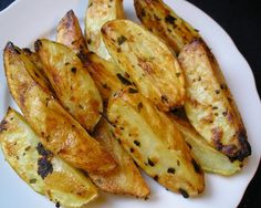 Stanley Tucci's Roasted Potatoes with Rosemary [People Magazine]. Serves 4.   • 5 large Yukon Gold potatoes, peeled and quartered  • 2 cloves garlic, halved  • 1½ tsp. chopped fresh rosemary leaves  • 1 tsp. chopped fresh oregano leaves, or ¼ tsp. dried  • Kosher salt  • Pepper  • 2 tbsp. olive oil     Preheat oven to 375 ....    http://www.people.com/people/archive/article/0,,20646586,00.html