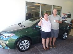 Joe and Patricia Typner with their beautiful forest green 2014 Corolla. Love the new color! :) #DavidMaus #Toyota