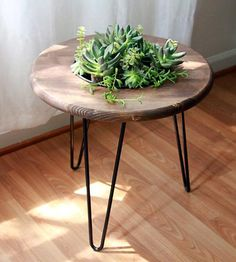 Spruce up your living room with this handmade side table, which features a built-in planter box. Finished in your choice of stain color, the wood tabletop has a recessed planter in the center for building your own miniature garden. Even better, some choice succulents are already included to get your garden party started.