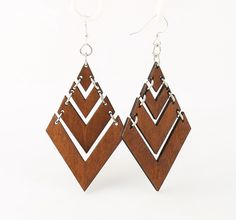 "Made In U.S.AStyle # 1440Size 2.7"" x 1.7""Fountain Pyramid EarringsPerfect to wear on any occasionMade from sustainably sourced wood and 90% recycled display cards. Laser-cut wood Stained with water based dye Ear wires are silver-finished 304L stainless steel, hypoallergenic, and enhanced with a new, smooth and consistent electrophoretic coating that resists tarnishing."