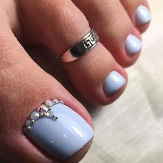 Blue pedicure with rhinestone gem details