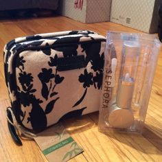 """Eco Beauty traveling cosmetic case + Extras BNWT Economically friendly cosmetic case that opens up and hangs. Double sided clear pockets and one small pocket near hanger. Plus Sephora travel kit (.51 oz fluid tube, .51 oz empty jar, pistol Pushkin stick, spatula and labels)  these are great for all the samples we collect to keep for our traveling days. Bag measures, closed: 8"""" x 6"""" x 3"""". Opens up and you can see from the pic, how much you can get in there and how convenient. Small but looks…"""