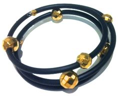 This must-have bracelet is crafted of black rubber and gold plated hematite. It's twisted look wraps comfortably around your wrist. The bracelet is allergy friendly and designed for all.