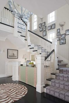 Love this foyer space. So open and loving the contrast between the white walls/rails and the dark treads/floor.