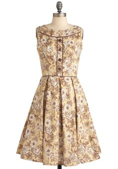 Your grandma said she noticed the cutie in the corner checking out the shades-of-sepia toile pattern of your dress, and your mother mentioned that the myterious character in the chair over there was taking a peek of the frock's brown piping and decorative button panel. $99.99
