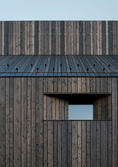 in the slovenian town of logatec, dekleva gregorič architects has completed 'chimney house', a timber dwelling that celebrates the role of the wood stove.