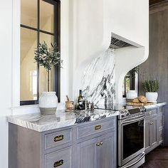 Gray Wash Kitchen Cabinets with Vintage Brass Pulls