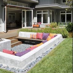 sunken concrete couch with wood planks