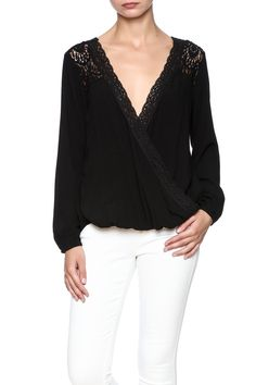 Long sleeve black blouse with a crossover front lace trimming and back cut out.  Crossover Blouse by Lovestitch. Clothing - Tops - Long Sleeve Clothing - Tops - Blouses & Shirts California