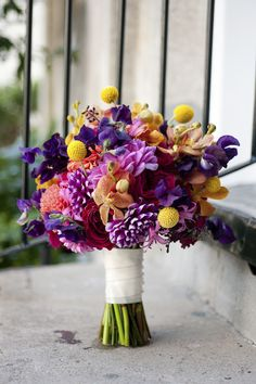 So fresh and vibrant! The perfect bouquet for summer. Photo by Leigh Webber via JunebugWeddings.com.