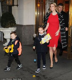Starting her day: Ivanka was flanked by her Secret Service detail as she stepped out of her Park Avenue apartment