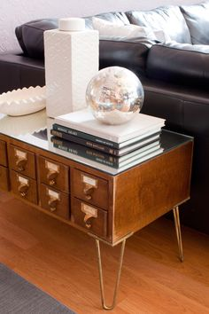 Love, love, love the antique library card box used as a sofa table. The mirror top really dresses it up.