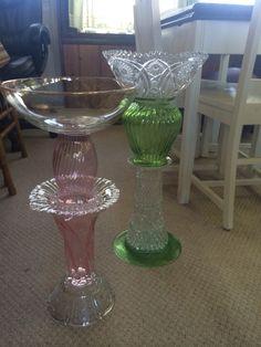 A couple of recycled glass birdbath a