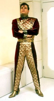 Arnold Rimmer-http://www.reddwarf.co.uk/features/history/evolution-of-rimmers-costumes/