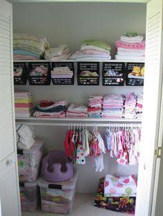 Nursery Closet {Organizational Ideas!} | Sawdust and Embryos.. hanging milk crates from the dollar store for extra shelf space.. socks, bibs,washcloths, etc