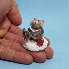 Handmade miniature Christmas mouse singing carols in the snow with tiny candy cane and wreath and mini salvation army bucket. Christmas Carol, Christmas Ornaments, Polymer Clay Animals, Miniature Christmas, Candy Cane, Dollhouse Miniatures, Singing, Bucket, Army