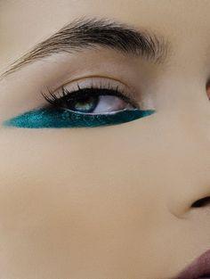Interesting streak of eyeliner on the bottom lid. [Makeup by Theresa Francine]
