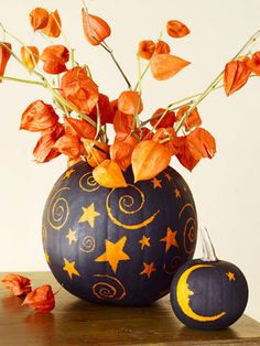 These vases do require a knife, but the celestial designs come courtesy of a spoon — not torturous slicing and dicing. Cut off the top of the pumpkin, and remove the innards. Spray-paint the rind a matte black and let dry. Use a spoon handle to scratch away paint to create stars, moons, and spirals. Add water and blooms.
