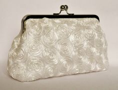 A beautiful and elegant brides clutch purse made from specially designed silk and satin fabric, lined with silver satin fabric and reinforced with