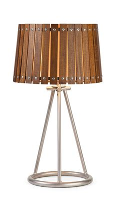 A natural appeal mixed with industrial style, the Acacia wood shade table lamp has the best of both worlds. A sturdy iron tripod style base is accented by the wood slats and screw head design.