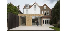 IQ Glass supplied our admired sliding glass doors to this contemporary extension space in Barnet. The small glazed extension was a new addition to a detached Victorian home