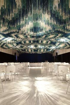 Amazing use of threaded ceiling art to alter the lighting and shape of a room visually, but not structurally.