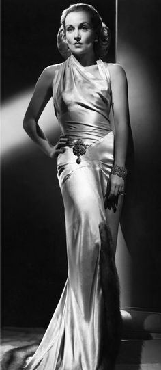 Vintage fashion style silk bias cut white dress halter glamour evening gown Carole Lombard, 1930s.  They just knew how to wear their satin in the 20's and 30's, didn't they?