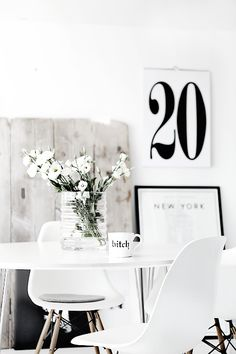 White decor palette shite flowers chair and table print frame New York vase of white flowers