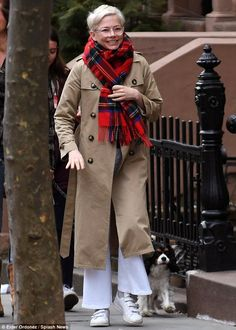 Keeping cozy: Michelle was bundled up during the chilly NYC day, donning a long trench-coat and red scarf