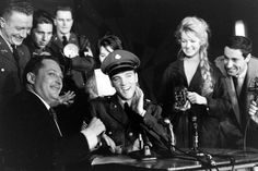 Not originally published in LIFE. Sgt. Elvis Presley at a press conference before leaving Germany, March 1960.