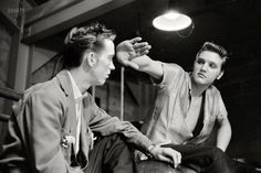 May 27, 1956. Dayton, Ohio. A 21-year-old Elvis Presley with his cousin Gene Smith backstage at the University of Dayton field house. 35mm negative by Phillip Harrington.